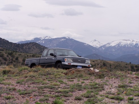 Truck with Tusher Mtns. South-Central Utah